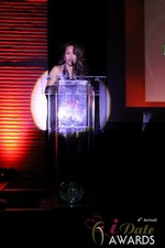 Carmelia Ray announcing Best Up and Coming Dating Site at the 2013 Las Vegas iDate Awards